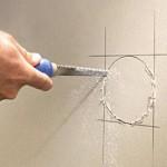 Man cutting drywall.