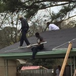 Men Roofing a Home