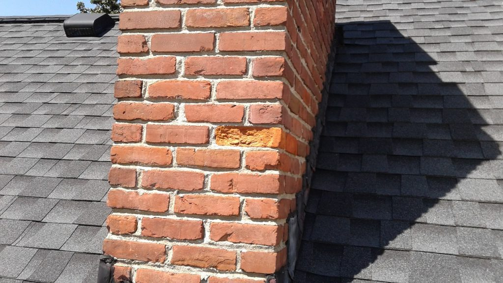 Spalling Masonry and Freeze-Thaw Weathering - Chimney with spalling brick